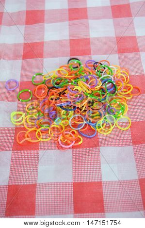 close up Colorful plastic band on tablecloth