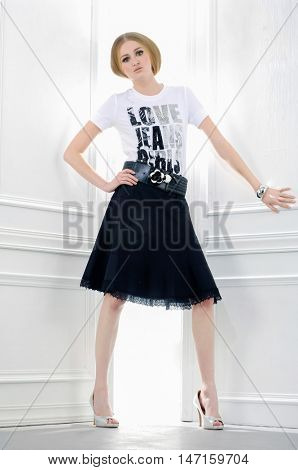 full-length fashion model in modern clothes posing in studio