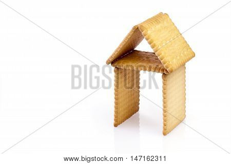 Biscuits in the shape of a house on white backgrond