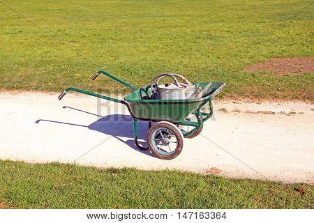 Drought: watering cans in a wheelbarrow, hot season