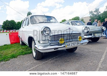 Kharkiv Ukraine - May 22 2016: Soviet retro car white sedan GAZ M21 Volga Third Series manufactured in 1969 is presented at the festival of vintage cars Kharkiv Retro Rally - 2016 in Kharkiv Ukraine on May 22 2016