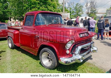 Kharkiv Ukraine - May 22 2016: Retro car cherry-blossom GMC Model 101 1/2-Ton Suburban Pickup Truck manufactured in1950's is presented at the festival of vintage cars Kharkiv Retro Rally - 2016 in Kharkiv Ukraine on May 22 2016