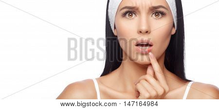 Herpes on the lips of the young woman. Shocked young woman touching pain her lips. Inflammation of the lip. Herpes on the lips, beauty concept. Woman with herpes virus. Woman Skin Care Concept poster
