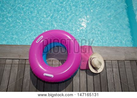 Buoy pink and blue with hat in the pool