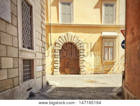 Elegant doorway of a roman building with grated windows
