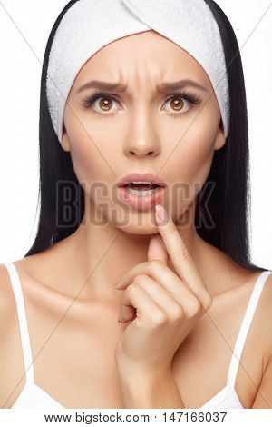 Herpes on the lips of the young woman. Shocked young woman touching pain her lips. Inflammation of the lip. Herpes on the lips, beauty concept. Woman with herpes virus. Woman Skin Care Concept