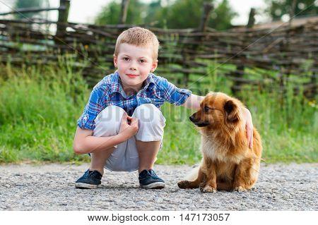 Child Lovingly Embraces His Pet Dog. Best Friends. Outdoor