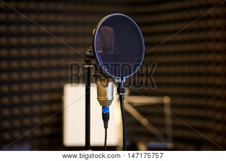 Condenser microphone in dark vocal recording room