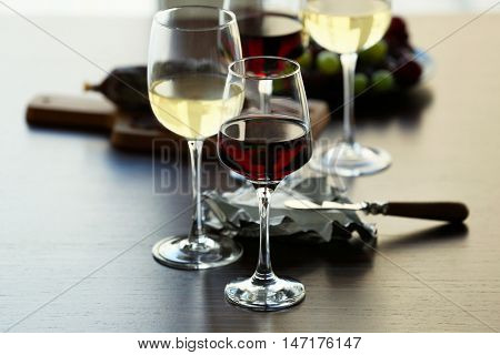 Glasses with wine on served table