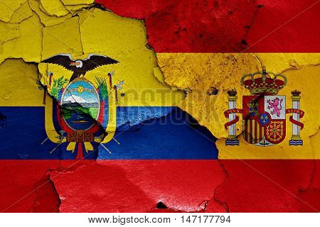 flags of Ecuador and Spain painted on cracked wall