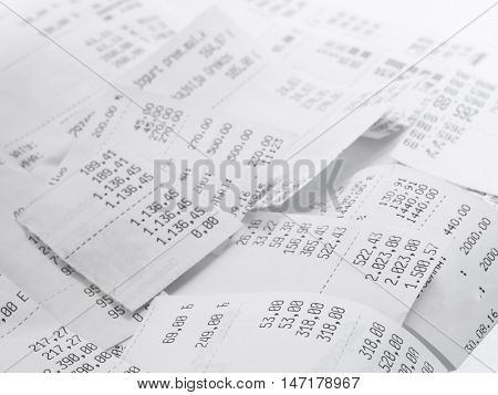 cash register receipts in a pile