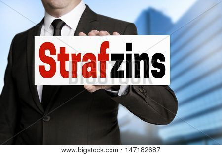 Strafzins (in German Negative Interest) Sign Is Held By Businessman