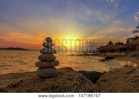 Stones Balance in sunrise at sea in august