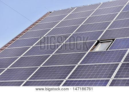 House roof with renewable energy solar and thermal photovoltaic panels