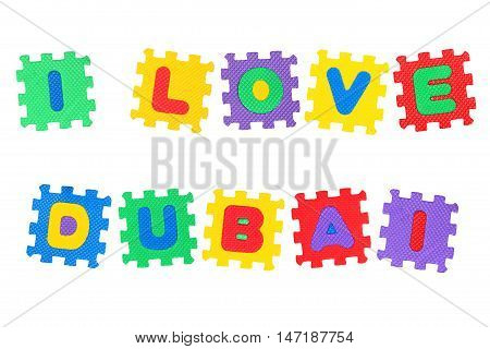 Message I Love Dubai from letters puzzle isolated on white background.
