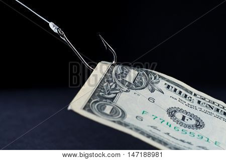 Money being reeled in on a fish hook hook - concept image for business - profits loss risk investment etc.