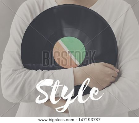 Female Holding Vinyl Music Graphic Concept