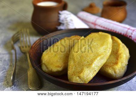 Fried Zeppelin (cepelinai) - Tradishional Lithuanian Potato Patty Stuffed With Meat.