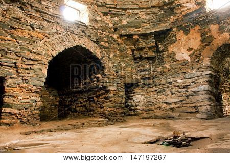 Interior of the all stone 15-th century caravanserai Tash Rabat in Kyrgyzstan. Some argue that it was originally a Nestorian or Buddhist monastery going back to the tenth century.