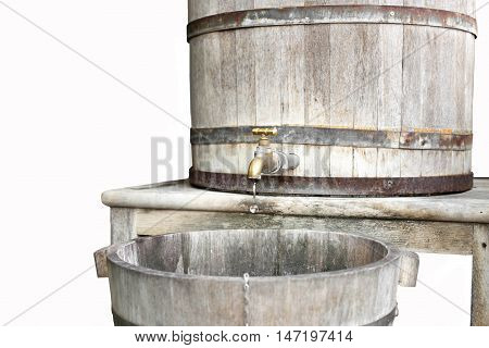 Selected focus on water tap wooden water tank in white background
