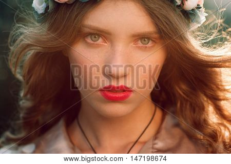 Beautiful woman with streaming hair portrait. Close up photo of attractive girl with green eyes and piercing look. Beauty, makeup, fashion concept