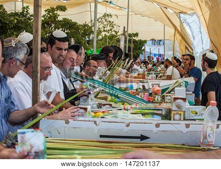 JERUSALEM, ISRAEL - OCTOBER 8, 2014: Sukkot in Israel. Religious Jews buy items, necessary during the holiday. Traditional holiday market in Jerusalem