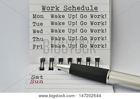 Text Work Schedule written on paper and a pen