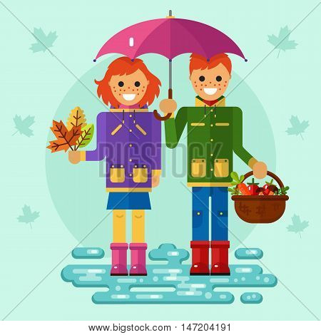 Flat design vector illustration of funny smiling boy and girl in jackets and rubber boots holding umbrella. Including autumn symbols: basket with vegetables, bunch of leaves, leaf fall, puddle.