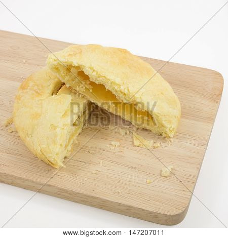 The Taiwanese sun cake (milk butter pastry) on the brown wooden plank.