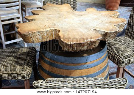 Unique and unusual rustic vintage restaurant table made from burr oak and wodden barrel