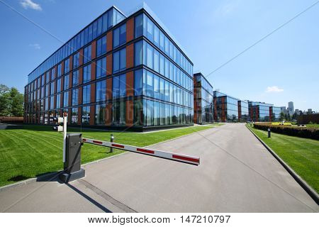 MOSCOW - JUN 03, 2015: Business center Olympia Park and barrier. Olympia Park complex has offices, sports complex and park