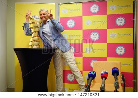 MOSCOW - JUN 03, 2015: Oleg Tinkoff poses with Giro d Italia award. Tinkoff Saxo bank - sponsor of Spanish team won cycling in Giro d Italia 2015