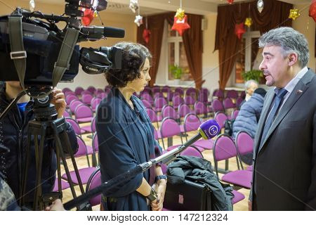 MOSCOW, RUSSIA - 4 FEB, 2015: Council chair of deputy in Bogorodskoe Volovik Konstantin Yefimovich is giving interview to young journalist.