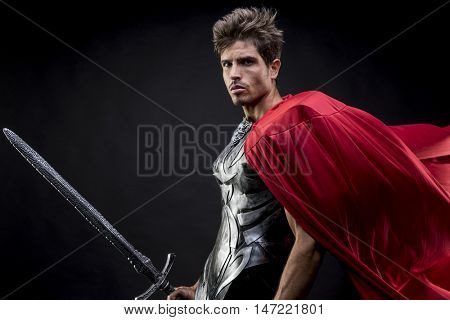 Soldier, centurion or Roman warrior with iron armor, military helmet with horsehair and sword