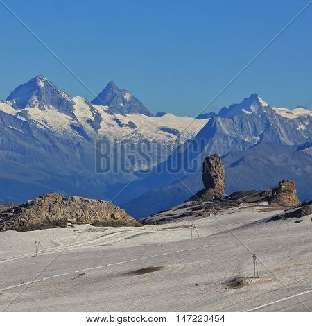 Quille du Diable famous rock in the Swiss Alps. Glacier de Diablerets. Distant view of the Matterhorn and other high mountains in Switzerland. poster