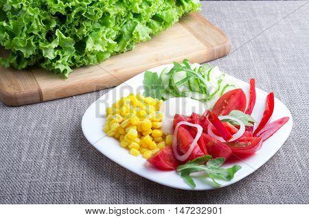 Useful Natural Salad On A Gray Tablecloth