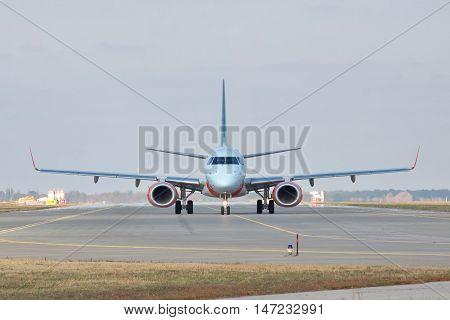 Kiev Region Ukraine - October 23 2011: Embraer ERJ-190 passenger plane on the runway front view