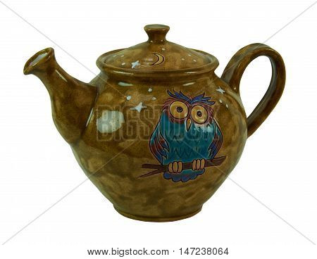 Colorful teapot - pottery handmade from clay glazed. Teapot decorated with patterned owls and moon. Isolated on a white background