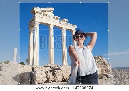 Pretty young woman take a self photo on the antique temple view post for social networks. Temple of ApolloSideTurkey