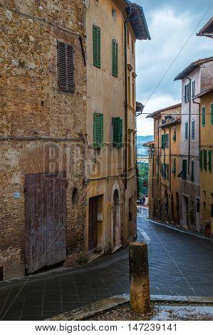 Narrow street of medieval town San Quirico d'Orcia