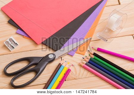 Back to school concept on a wooden background
