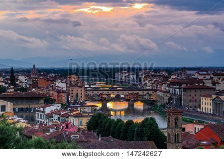 FLORENCE, ITALY - May 20: Ponte Vecchio arch bridge over the Arno River on May 20, 2016 in Florence, Italy.