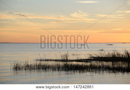 The photo of colorful sunset over the Baltic Sea.
