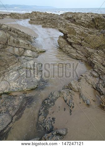 Rockpool river beach seascape photographed at Saunderfoot in Pembrokeshire