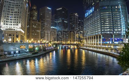 CHICAGO USA - JUNE 4 2016: The Chciago River runs through downtown Chicago dividing the business district on the left from the River North Gallery District on the right. Breathtaking views can especially be had at night.