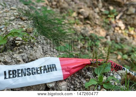 German barrier tape in forest - Mortal Danger