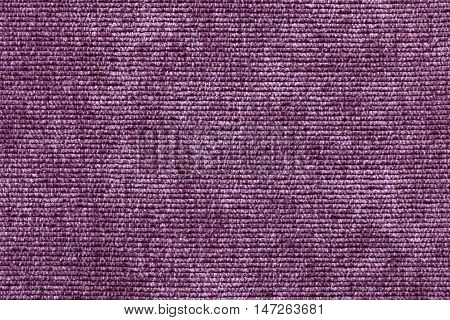 Purple background from a soft textile material. sheathing fabric with natural texture. Cloth backdrop.
