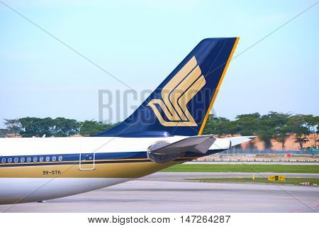 singapore, singapore - september 2, 2016: aircraft docked at Changi Airport. Singapore Changi Airport, is the primary civilian airport for Singapore, and one of the largest transportation hubs in Southeast Asia