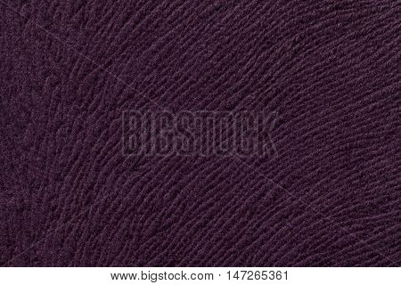 Dark purple background from a soft wool textile material closeup. Fabric with natural texture. Cloth backdrop.