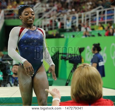 RIO DE JANEIRO, BRAZIL - AUGUST 11, 2016: Olympic champion Simone Biles of United States after competing on the balance beam at women's all-around gymnastics at Rio 2016 Olympic Games